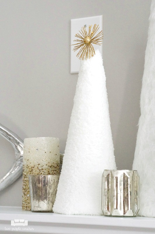 Beautiful idea for winter decorating - use simple white cone trees paired with candles!