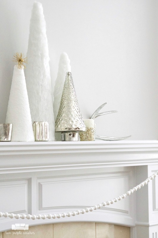 "Simple trees and mercury glass create a beautiful ""winter whites"" mantel display"
