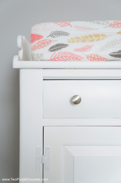 Repurpose an old cabinet into a functional changing table. Fresh new paint and updated hardware give it a modern look.