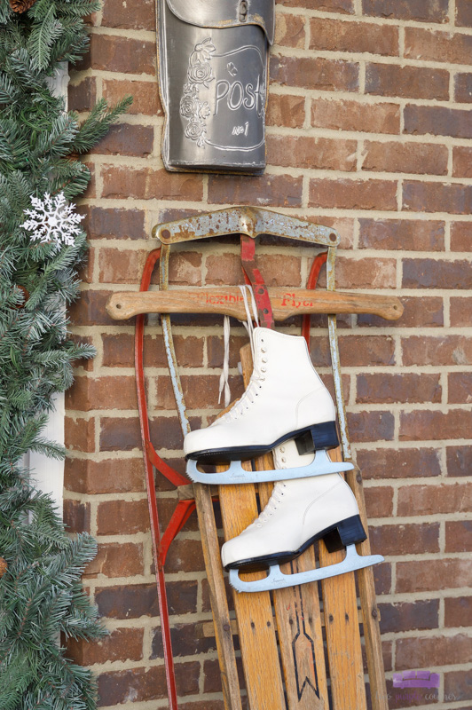 Christmas Front Porch Decor with Vintage Sled and Ice Skates