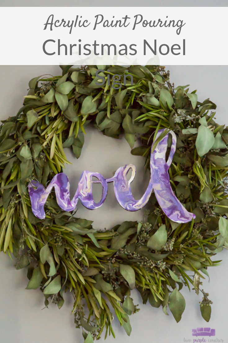 Noel sign created with DIY acrylic paint pouring technique turns a wooden sign into a unique and beautiful modern Christmas decoration!