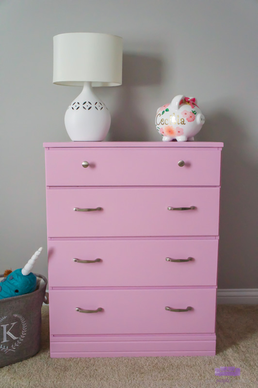 Baby girl dresser makeover for a nursery. Easy DIY tutorial on how to paint furniture with a paint sprayer. #paintedfurniture #paintsprayer