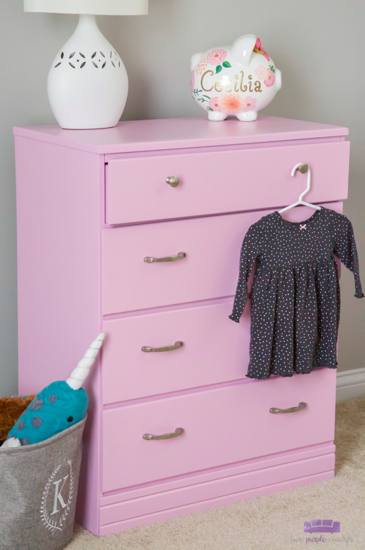Baby girl dresser makeover DIY idea for a nursery. Check out this before and after and learn how to paint a chest of drawers with a paint sprayer. #dressermakeover #furnituremakeover #paintedfurniture #paintsprayer #ad