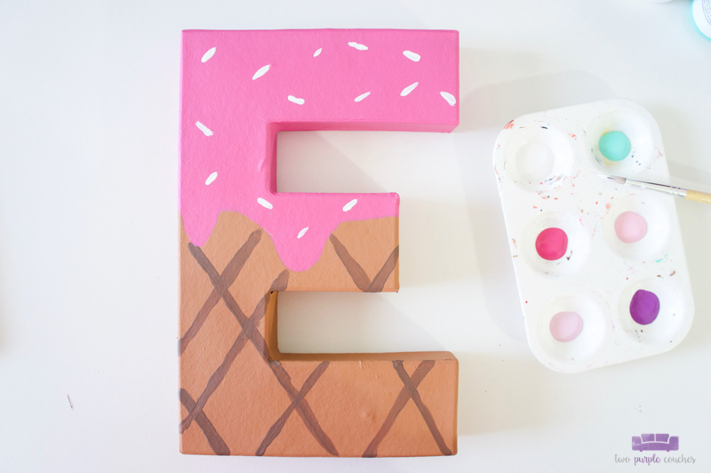 add sprinkles to painted ice cream letter