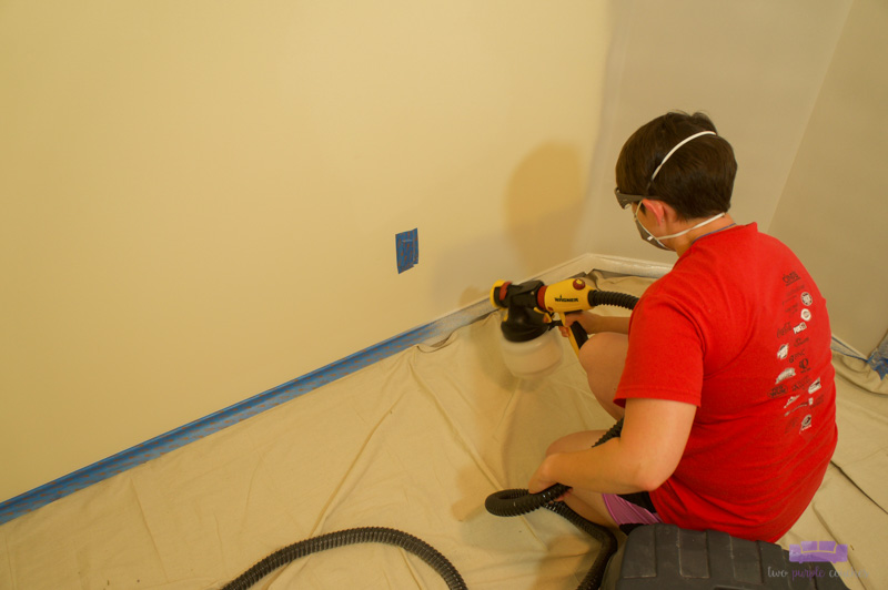 painting laundry room with paint sprayer