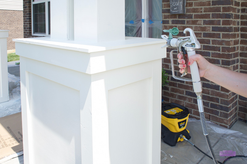 painting porch column with sprayer