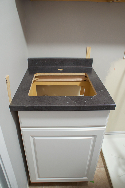 cabinet in place for laundry sink